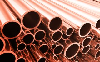 Industry business production and heavy metallurgical industrial products, many shiny steel pipes, industrial background, manufacturing business production concept, copper pipes with selective focus effect, 3D illustration